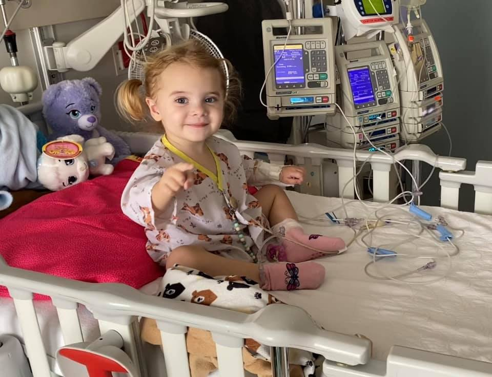 Hallie Thiessen sits in her hospital bed.
