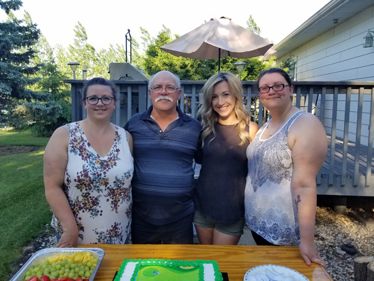 Guy Roy with his daughters (from left to right) Mireille Roy-Tarzia, Lynne Roy, and Melanie Glesby