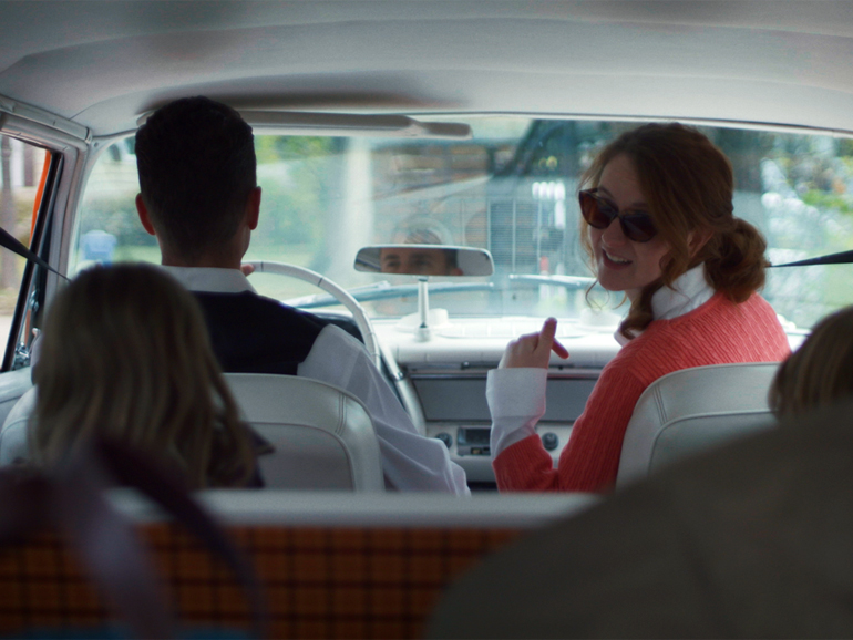 A still shot from a scene in the film - Laura in a car with family