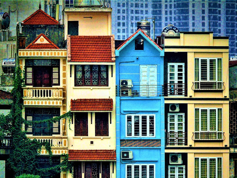 Colourful multi-storied and narrow buildings in Vietnamese neighbourhood.