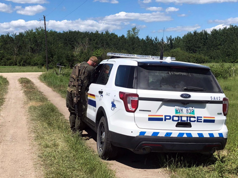 An officer is pictured on the scene of Wildman's property in the R.M. of St. Clements on Tuesday. (RCMP Manitoba)