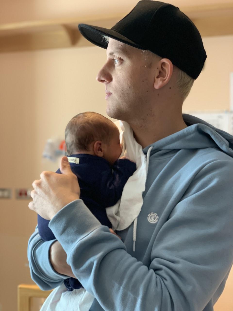 Jordan Janzen with his newborn son Aiden.