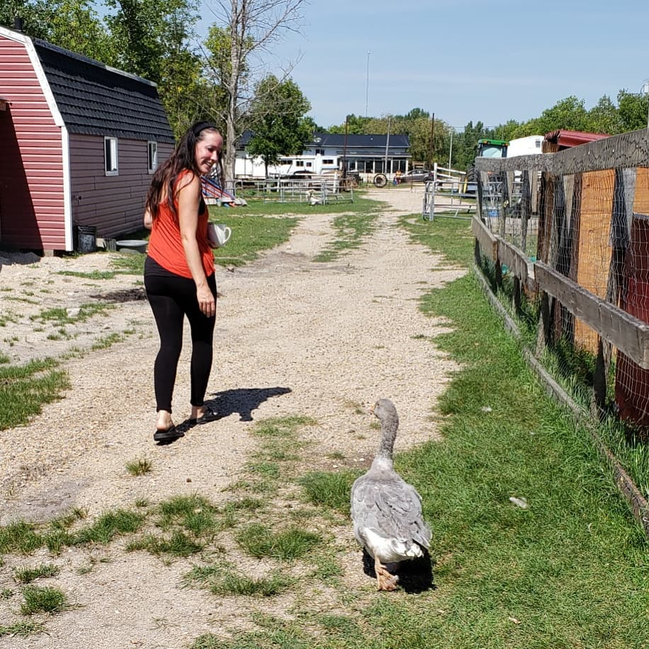 Lucy Sloan with a duck on her animal therapy farm.