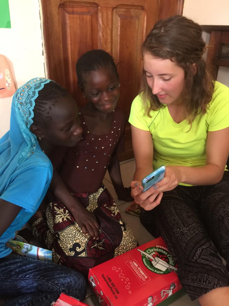 Kaylee handing out shoeboxes in Senegal, Africa.