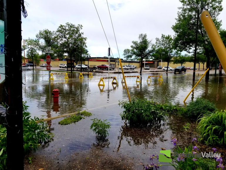 Altona's downtown drainage system was overwhelmed by the burst of rain.
