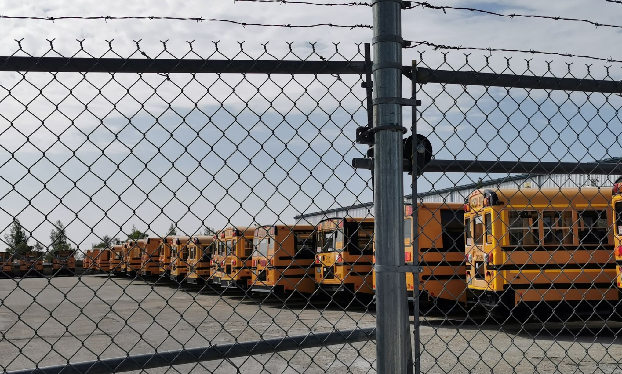 bus behind fence