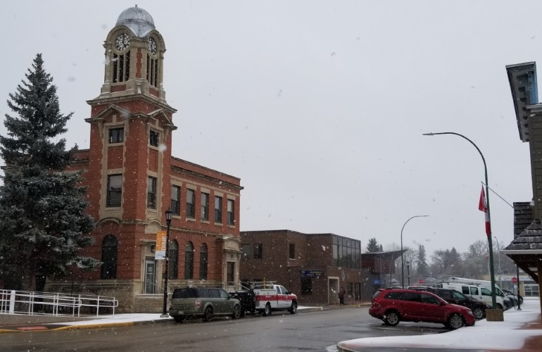 Carman's library - an old brick building with a large clock tower on the corner.