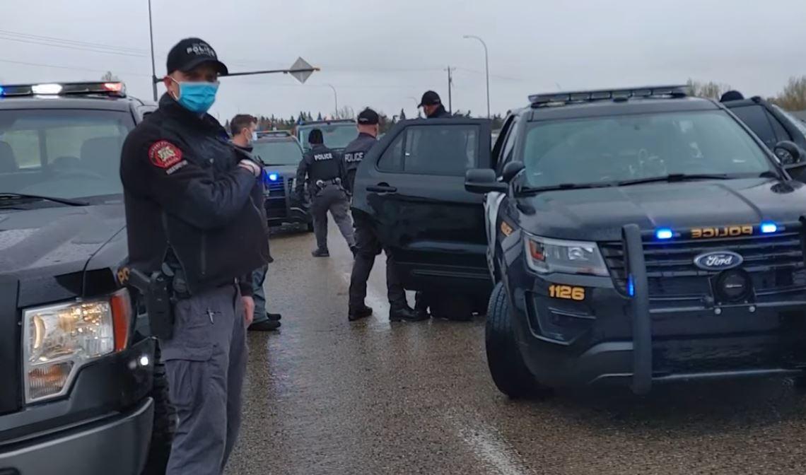Multiple Calgary Police Service (CPS) vehicles on the scene of Pawlowski's arrest. (Screenshot: Artur Pawlowski/Facebook)
