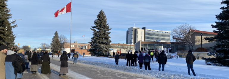 A crowd of 50 to 100 people gathered for the Hugs Over Masks protest in Steinbach Saturday.